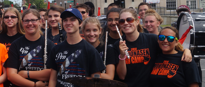 Students holding instruments and smiling