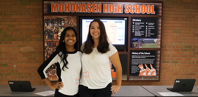 Students pose in front of Mohonasen High School sign