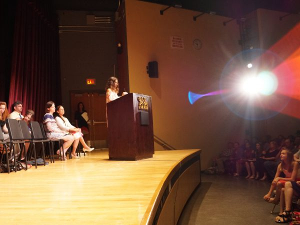 girl stands at podium