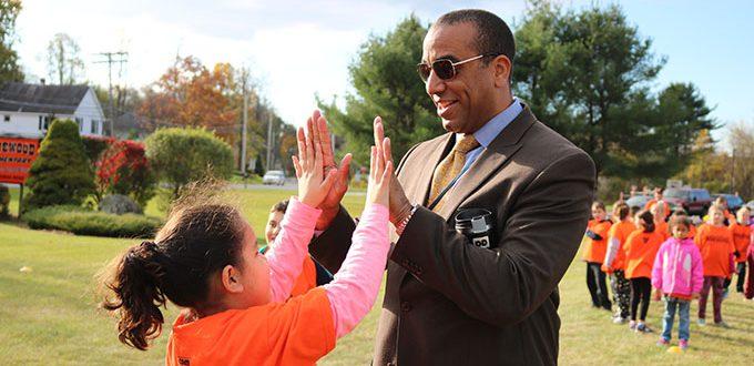 Student gives teacher high-fives
