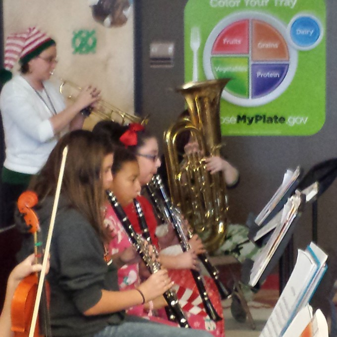 Students and staff playing instruments