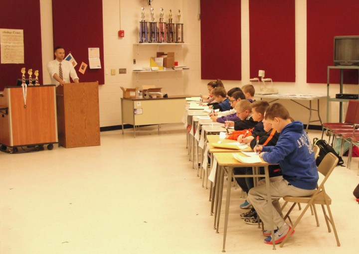 Students at desks participating in competition
