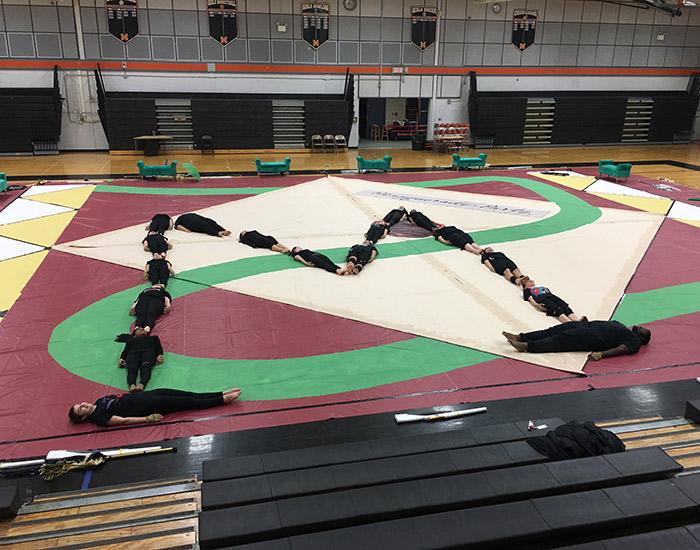 Students form an M shape on floor