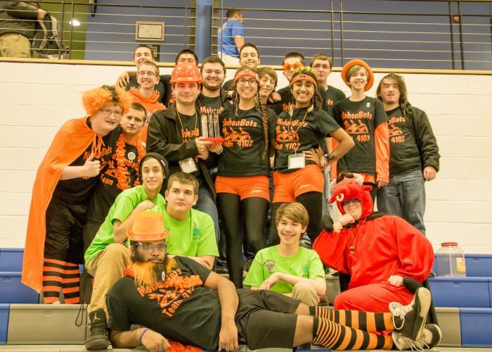 Robotics team poses for photo