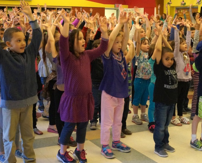 Students stretching arms upward