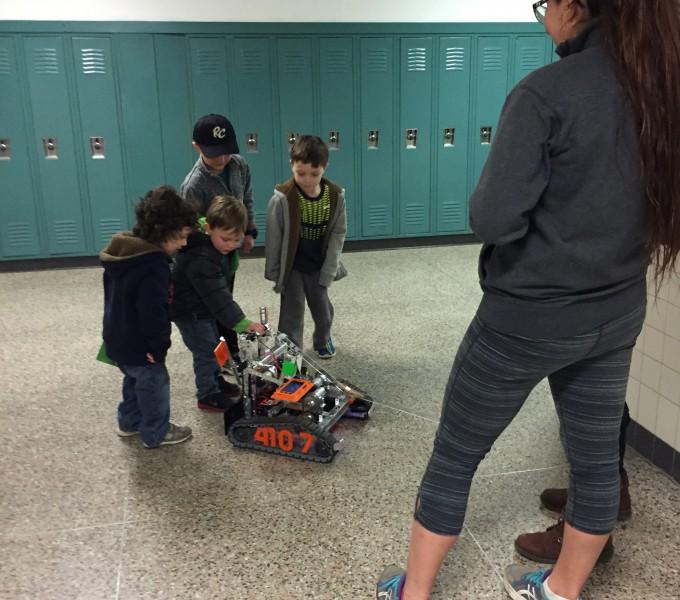 students in hallway with robotic machine