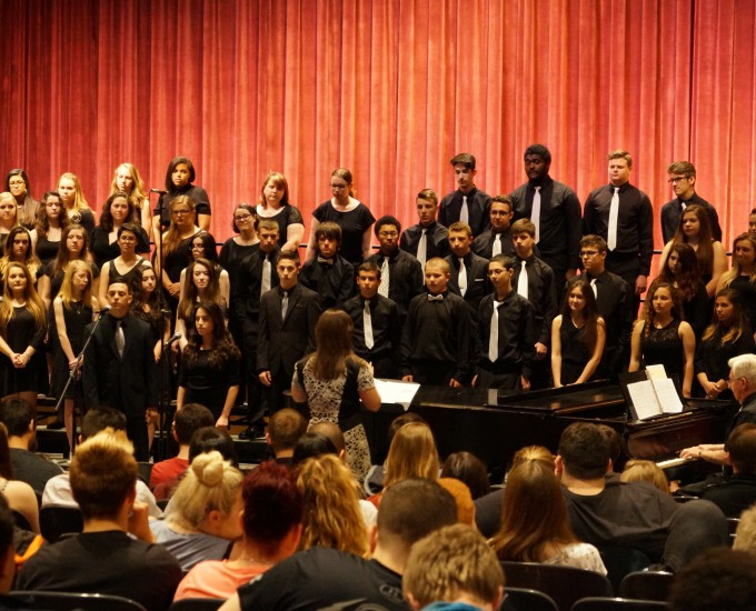 Student choir performing on stage