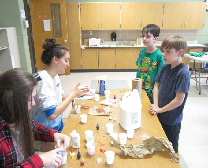 Students participating in science demonstrations