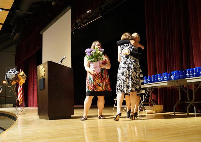 Principal hugs retiring teacher