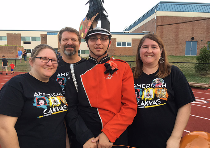 Marching band members pose for photo