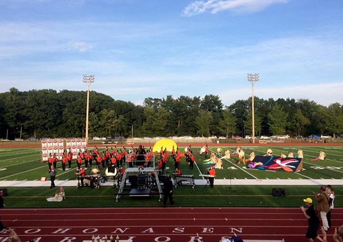 Full marching band performs on field