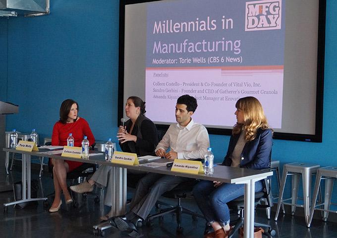 Panel presenters speak to audience members