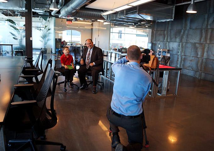 Student Mason Varga and father Jason Varga interviewed by news crew