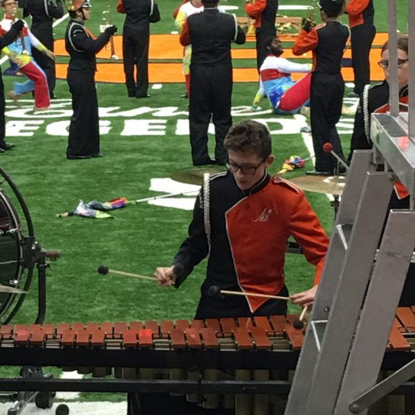 Student plays the xylophone