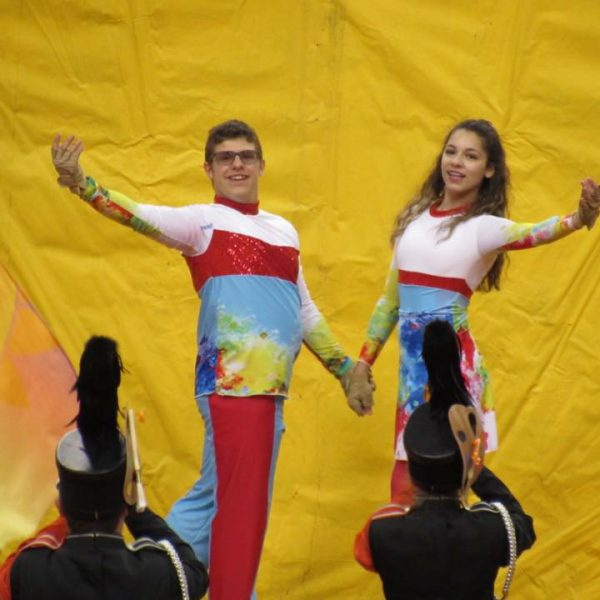 Color guard students perform