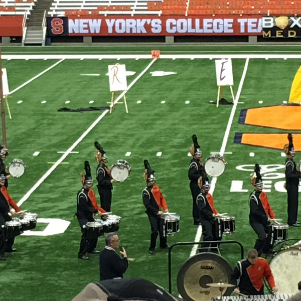 Students at marching band competition on field