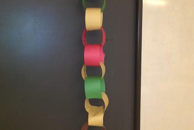 Holiday cheer chain adorns a wall
