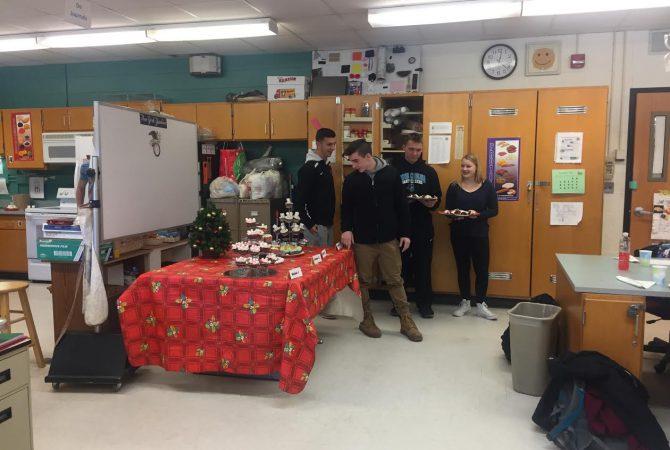 Students look at display of cupcakes