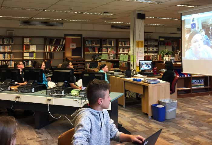 Students working at laptops in library