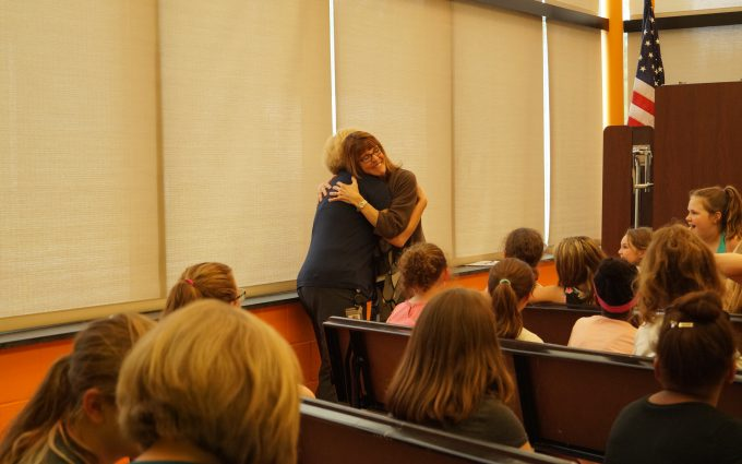 Composer and teacher hug
