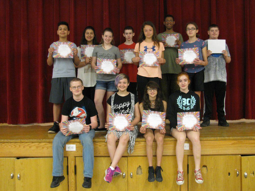 twelve students holding certificates