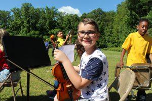 student holding violin