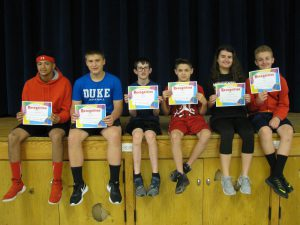 students pose with certificates