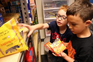 Students pick through pantry items in Bradt Food Pantry.