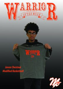 student wears a warriors tshirt and smiles. warrior is displayed in the background.