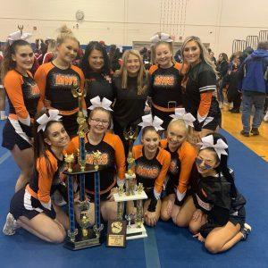 mohonasen cheer team poses with trophy