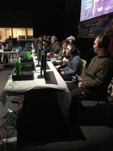 students participating in gaming event with gaming consoles