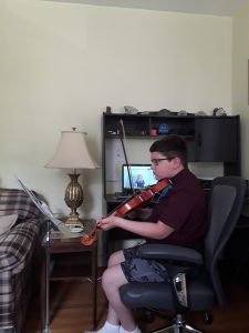 students play an instrument over google meet