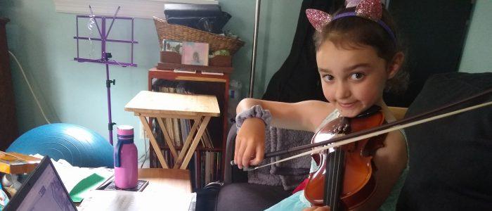 students play an instrument over google meet
