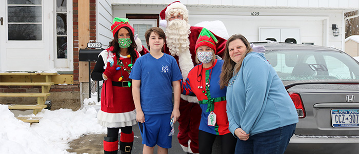 Santa Shannon Shine with Draper Staff Delivering holiday sweets to students
