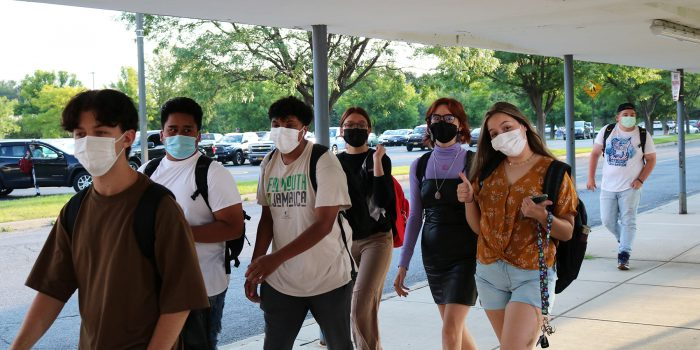 Mohonase HS students walking in to the school on opening day 2021