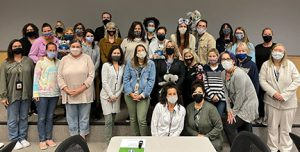 Mohonasen Faculty and staff pose for a photo during professional development day Oct. 8. Staff learned how to apply youth mental health first aid. abouStaff learned